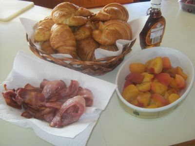 Bacon, croissants, peaches and maple syrup